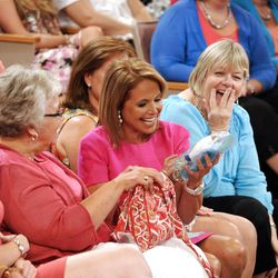 """Television show host Katie Couric sits with audience members during a taping  of her new talk show """"Katie."""" Couric's show made its debut Monday on ABC."""
