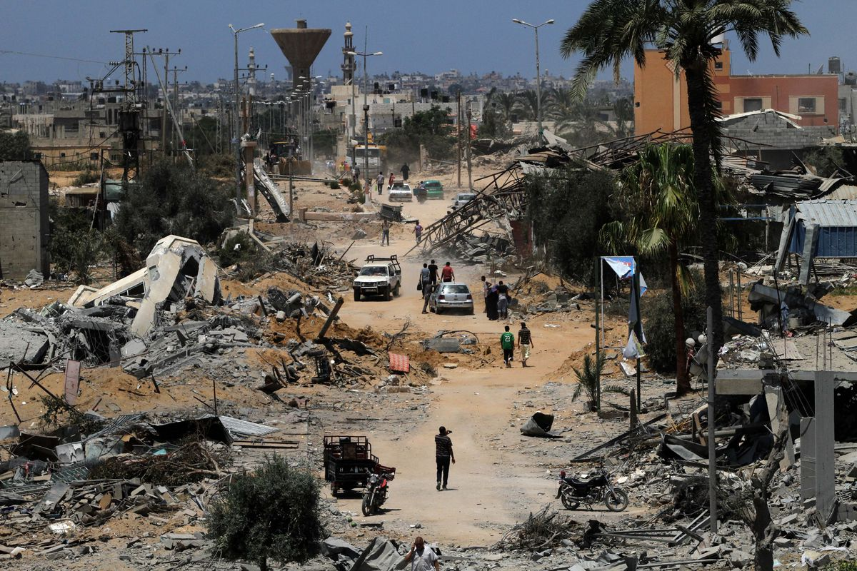 KHAN YUNIS, GAZA - AUGUST 3: Palestinians inspect destroyed buildings and collect usable stuff following an Israeli air assault staged within the scope of 'Operation Protective Edge' in Huzaa district of Khan Yunis, Gaza on August 3, 2014.