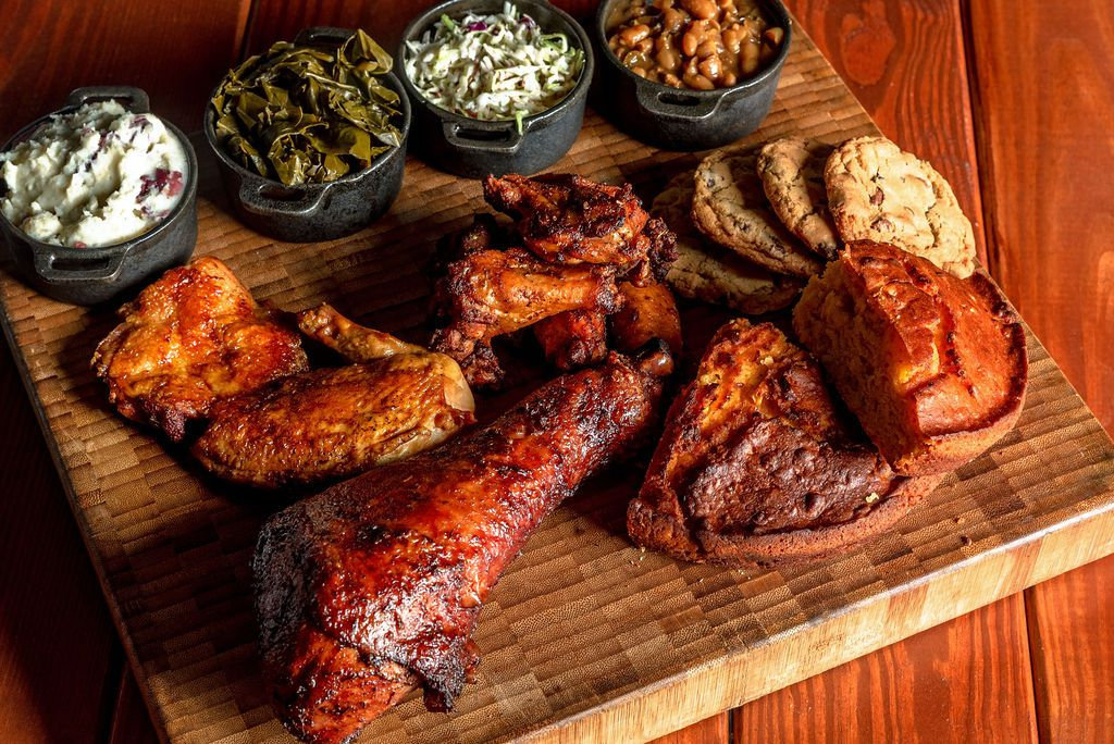 """A """"poultry party"""" from Money Muscle BBQ comes with wings, barbecue chicken, and a brined turkey leg."""