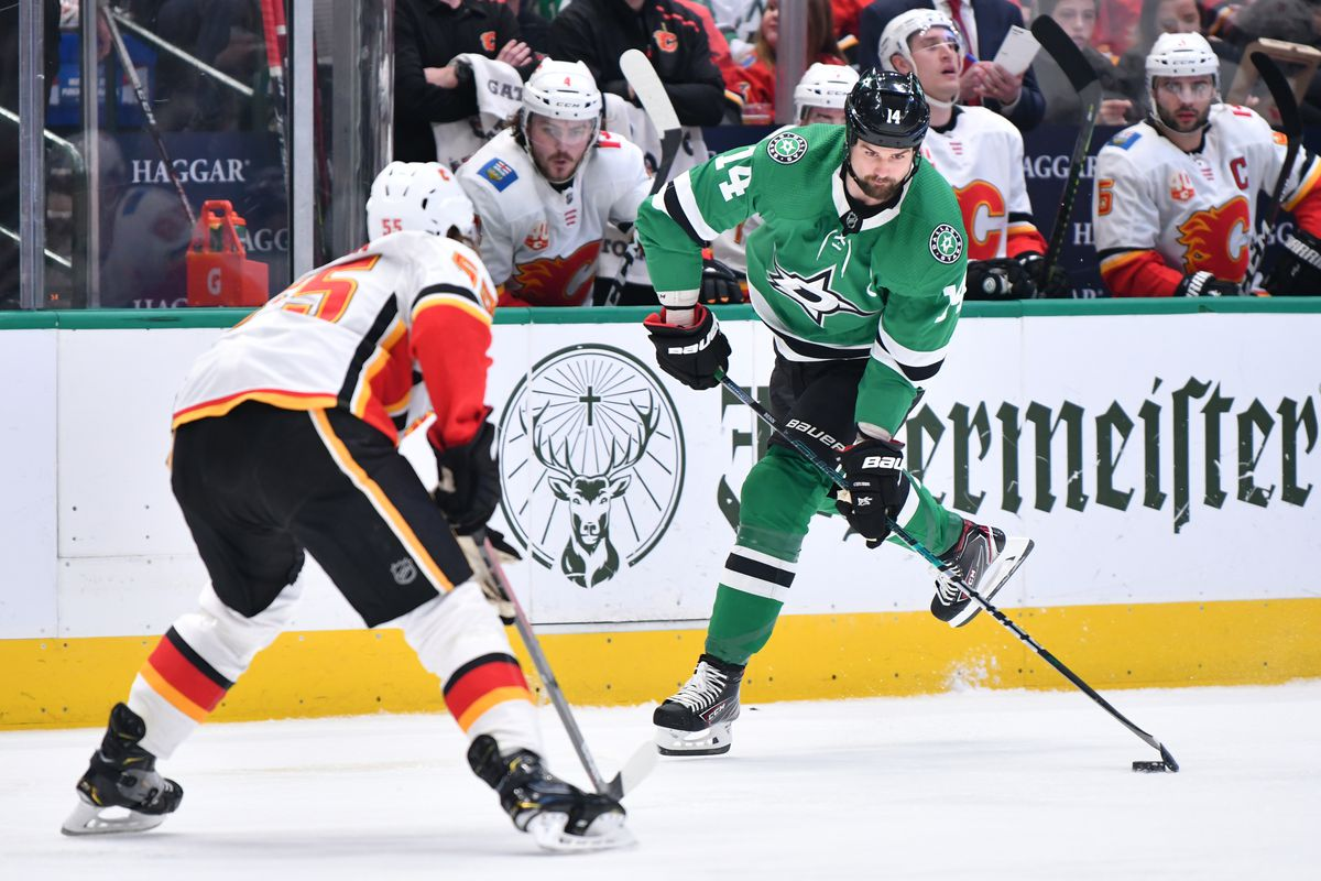 Jamie Benn of the Dallas Stars handles the puck against the Calgary Flames at the American Airlines Center on December 22, 2019 in Dallas, Texas.