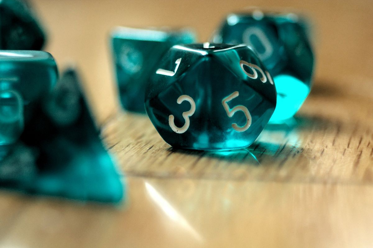 20-sided translucent dice on a table.