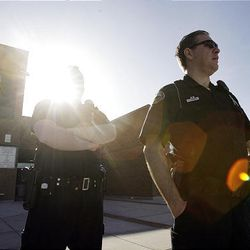 Sandy police officers stand outside Alta High School in Sandy Tuesday, March 29, 2011. The school's principal and assistant principal have been placed on administrative leave.