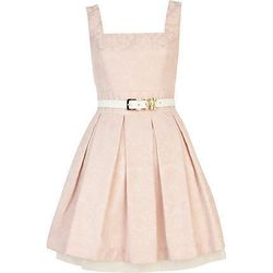 "<a href=""http://us.riverisland.com/women/dresses/party--evening-dresses/Pink-jacquard-belted-box-pleat-prom-dress-635257"">River Island</a> pink jacquard belted box pleat dress, $130"