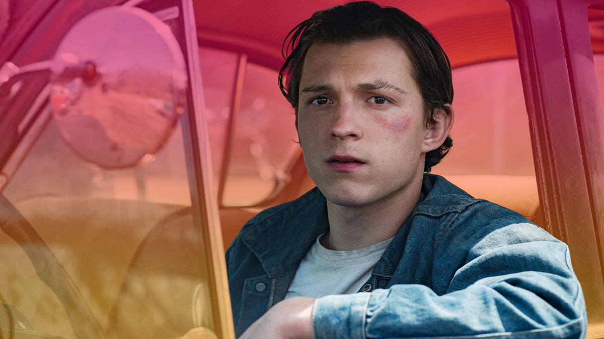 Tom Holland looks out of an open car window in the movie The Devil All The Time