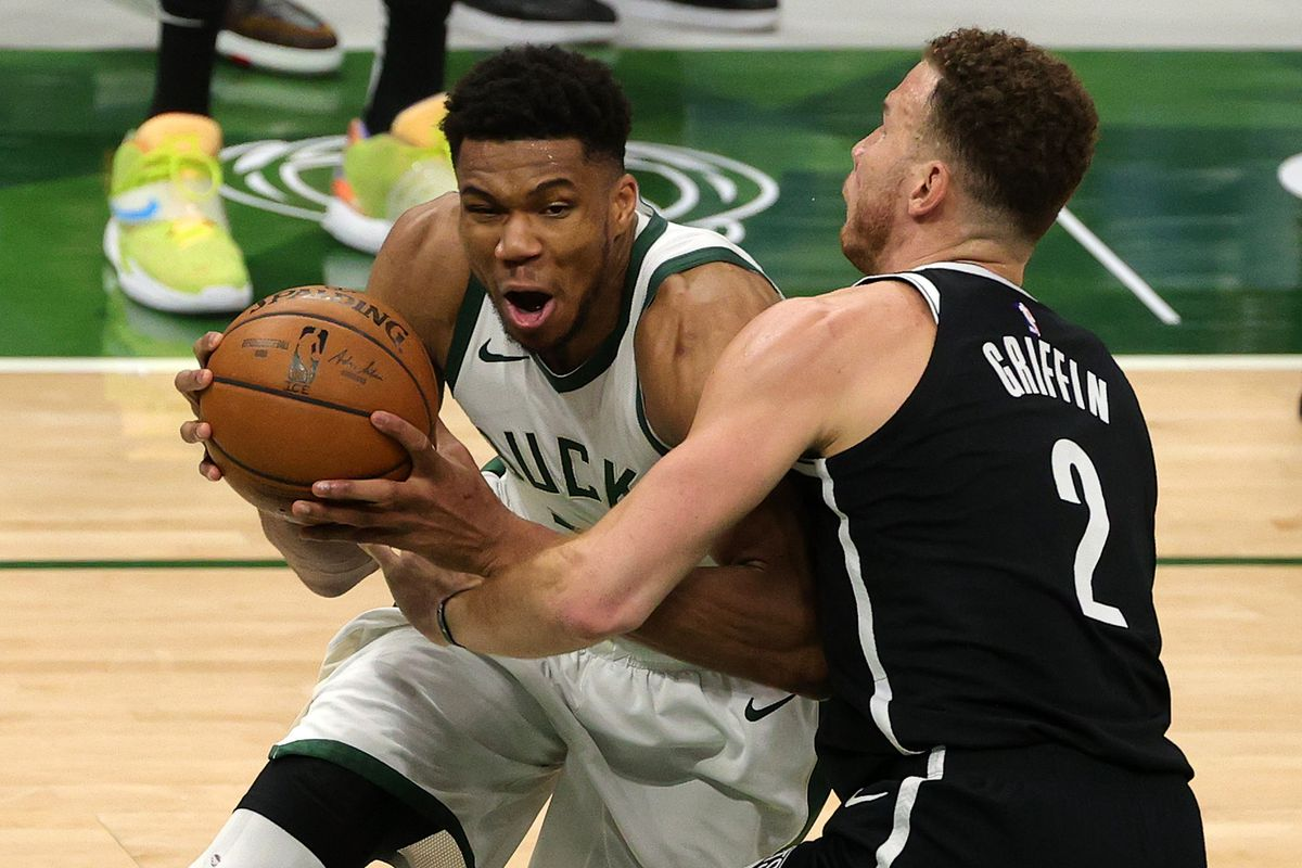 Giannis Antetokounmpo of the Milwaukee Bucks is defended by Blake Griffin of the Brooklyn Nets during the second half of a game at Fiserv Forum on May 04, 2021 in Milwaukee, Wisconsin.