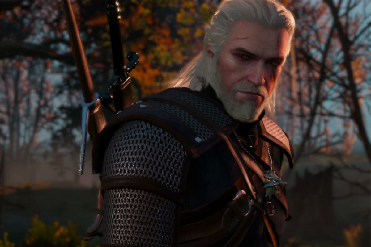 A man with white hair and armor looks off-camera