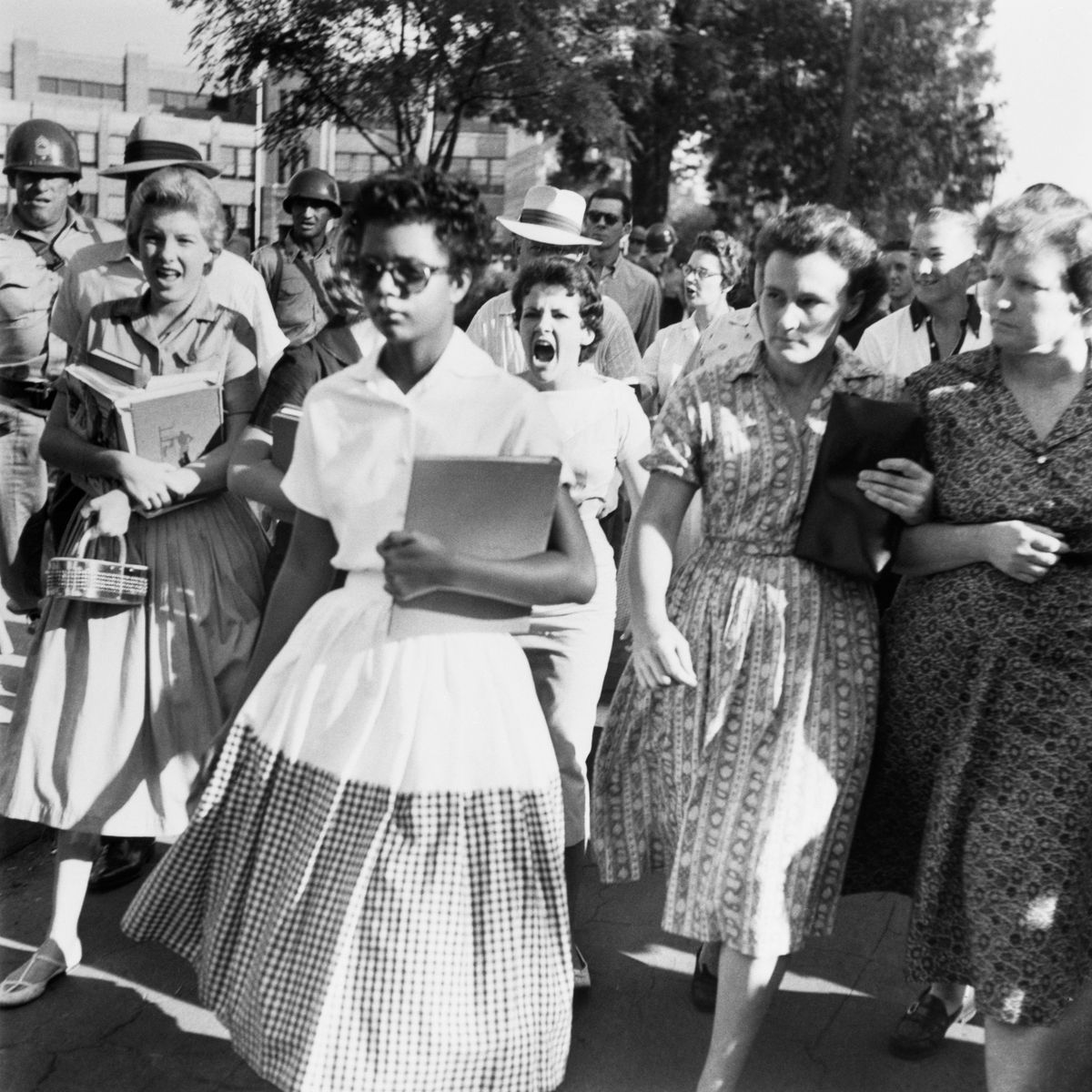 A Black female student being shouted at by white people, circa 1957.
