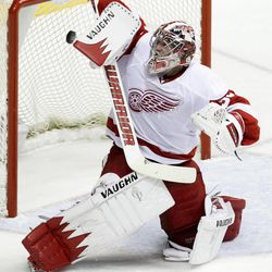 Detroit Red Wings goalie Jimmy Howard reaches for the puck as it gets past him for a goal by Nashville Predators' Matt Halischuk in the second period of Game 1 of a first-round NHL hockey playoff series on Wednesday, April 11, 2012, in Nashville, Tenn.