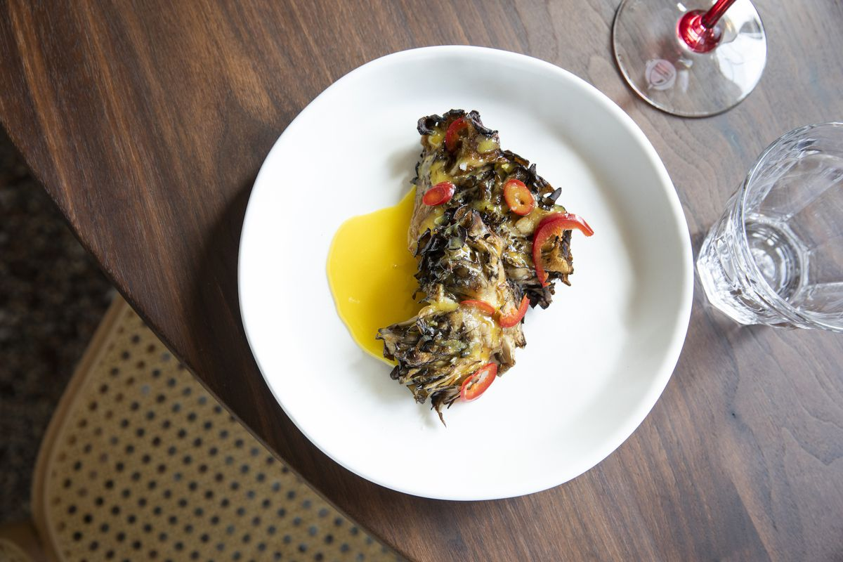 Grilled hen of woods mushrooms with emulsified egg yolk and chiles