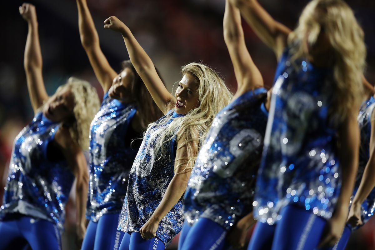 Members of the Cougarettes perform at LaVell Edwards Stadium.