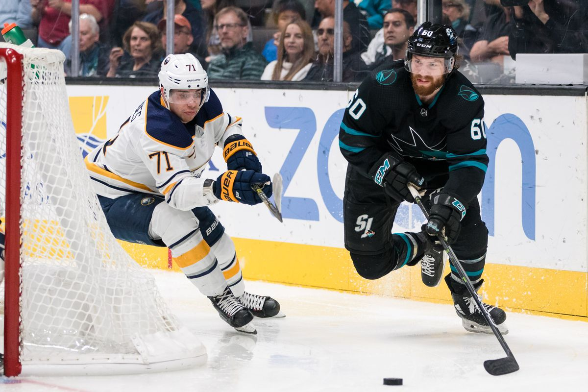 Oct 18, 2018; San Jose, CA, USA; San Jose Sharks center Rourke Chartier (60) passes as Buffalo Sabres left wing Evan Rodrigues (71) defends in the second period at SAP Center at San Jose.