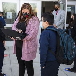 Middle school students check in with CPS Staff at Richardson Middle School at 6018 S Karlov Ave in West Lawn, Monday, March 8, 2021.