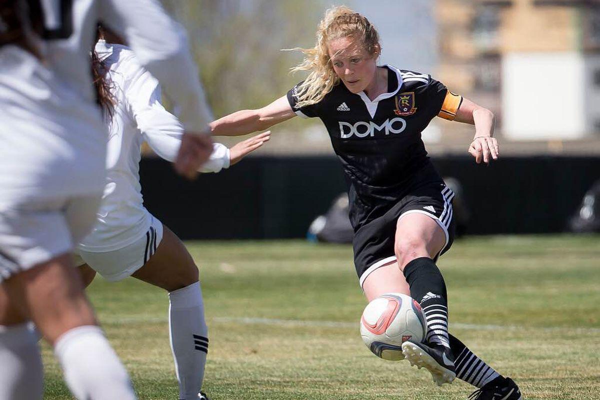 Captain Annie Hawkins dribbles past defenders (photo by Trev Mozingo)