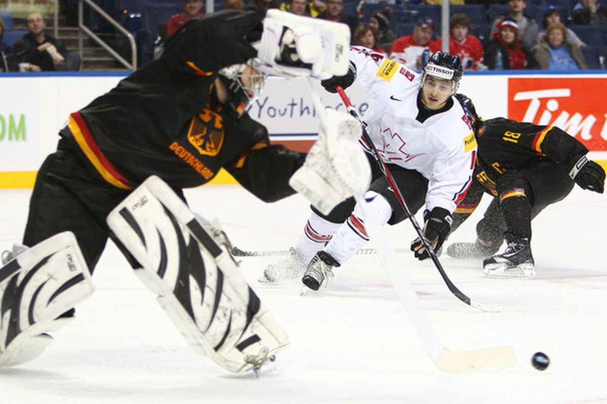 Switzerland beat Germany 4-3 in the opening game of the tournament, despite Germany outshooting the Swiss big time.  Clearly, Switzerland belongs at this event while Germany doesn't. (Photo by Tom Szczerbowski/Getty Images)