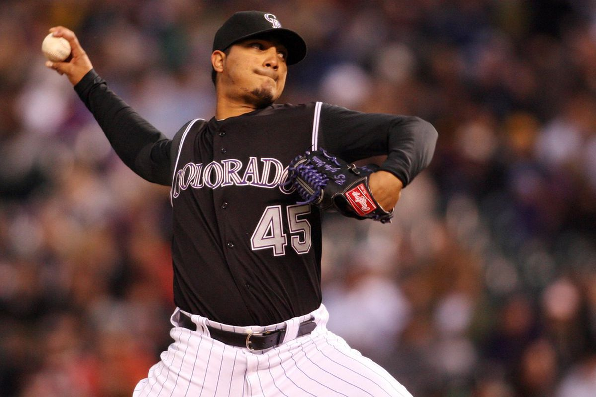 April 14, 2012; Denver, CO, USA; Colorado Rockies pitcher Jhoulys Chacin (45) delivers a pitch during the third inning against the Arizona Diamondbacks at Coors Field.  Mandatory Credit: Chris Humphreys-US PRESSWIRE