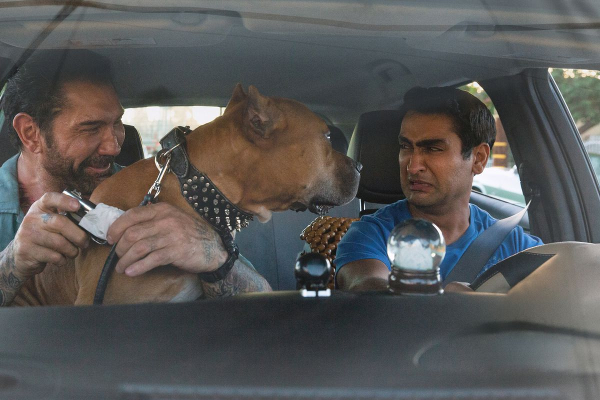 Dave Bautista and Kumail Nanjiani in Stuber. Nanjiani is not happy with a dog crowding them in the car.