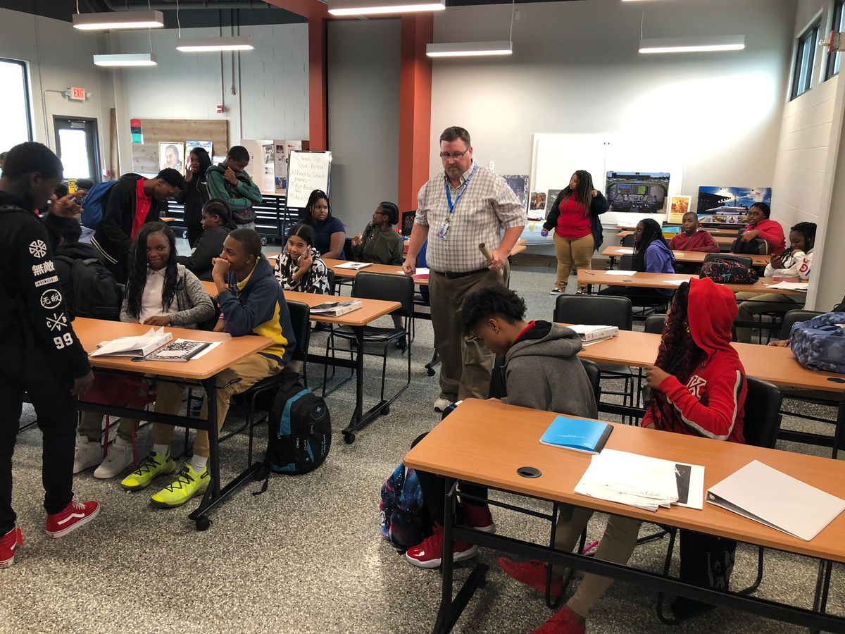 Students pack up at the end of the school day at Davis Aerospace Technical Academy. The runway at the Detroit municipal airport is steps away from this classroom.
