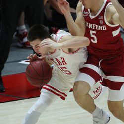 Utah Utes guard Rylan Jones (15) is fouled by Stanford Cardinal guard Michael O'Connell (5) in Salt Lake City on Thursday, Jan. 14, 2021. The Utes won 79-65.