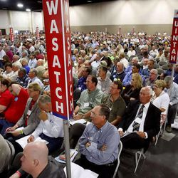 Delegates sit and listen at the beginning of the 2011 Republican State Convention Saturday, June 18, 2011 at South Towne Exposition Center.
