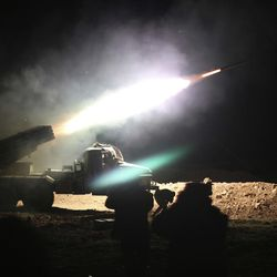 """FILE - In this Feb. 17, 2016 file photo, soldiers from the Syrian army fire a rocket at Islamic State group positions in the province of Raqqa, Syria. A major battle to liberate the northern Syrian city of Raqqa from Islamic State militants is looming, with U.S. officials looking to build on momentum from the battlefields in Mosul. Armed with a new Pentagon plan to """"rapidly defeat"""" the militants in both countries, President Donald Trump is now mulling options for upping the fight, which a top U.S. commander says he expects to be concluded within six months."""