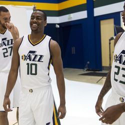Utah Jazz guard Alec Burks, center, laughs with forward Chris Johnson, right, and center Rudy Gobert during Media Day at Zions Bank Basketball Center in Salt Lake City on Monday, Sept. 26, 2016.