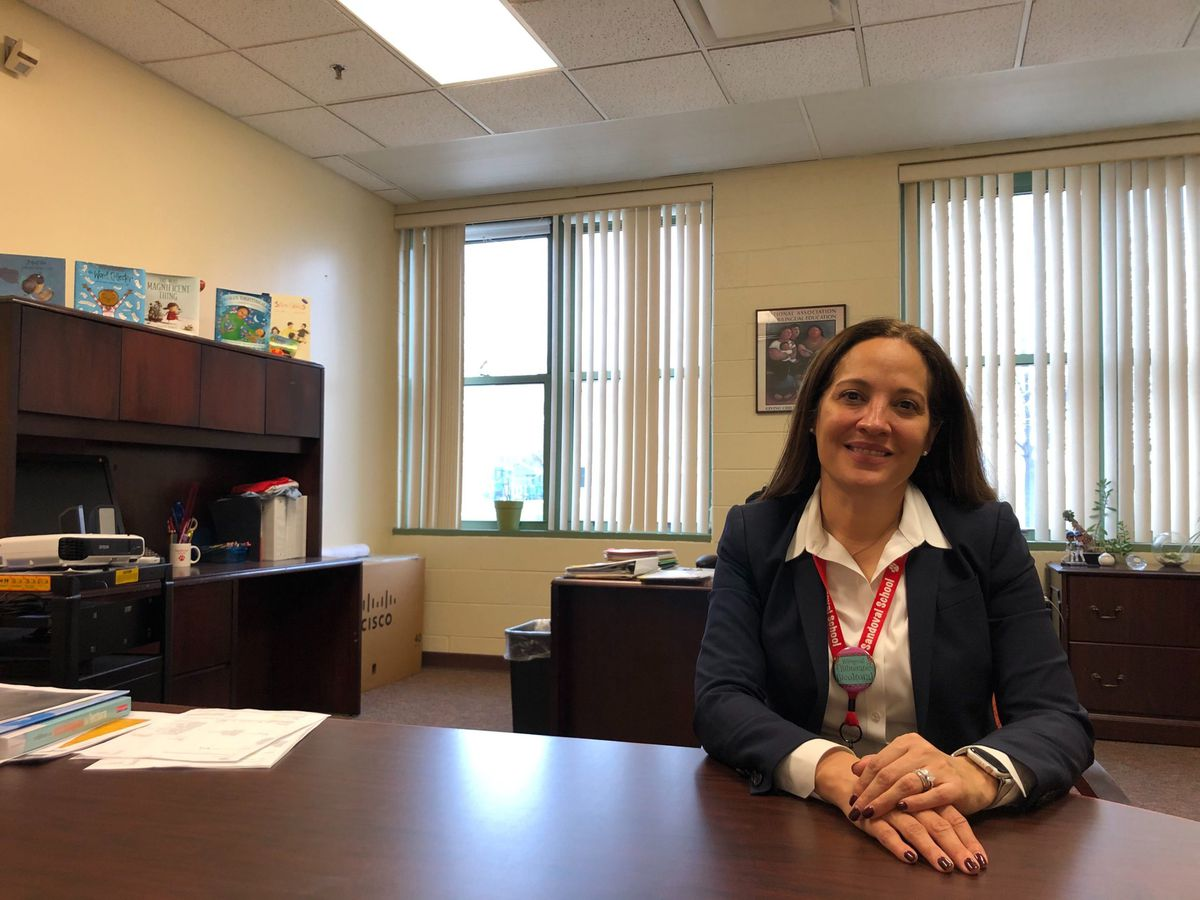 Wilma Milagros David, principal of Sandoval, sits in her office.