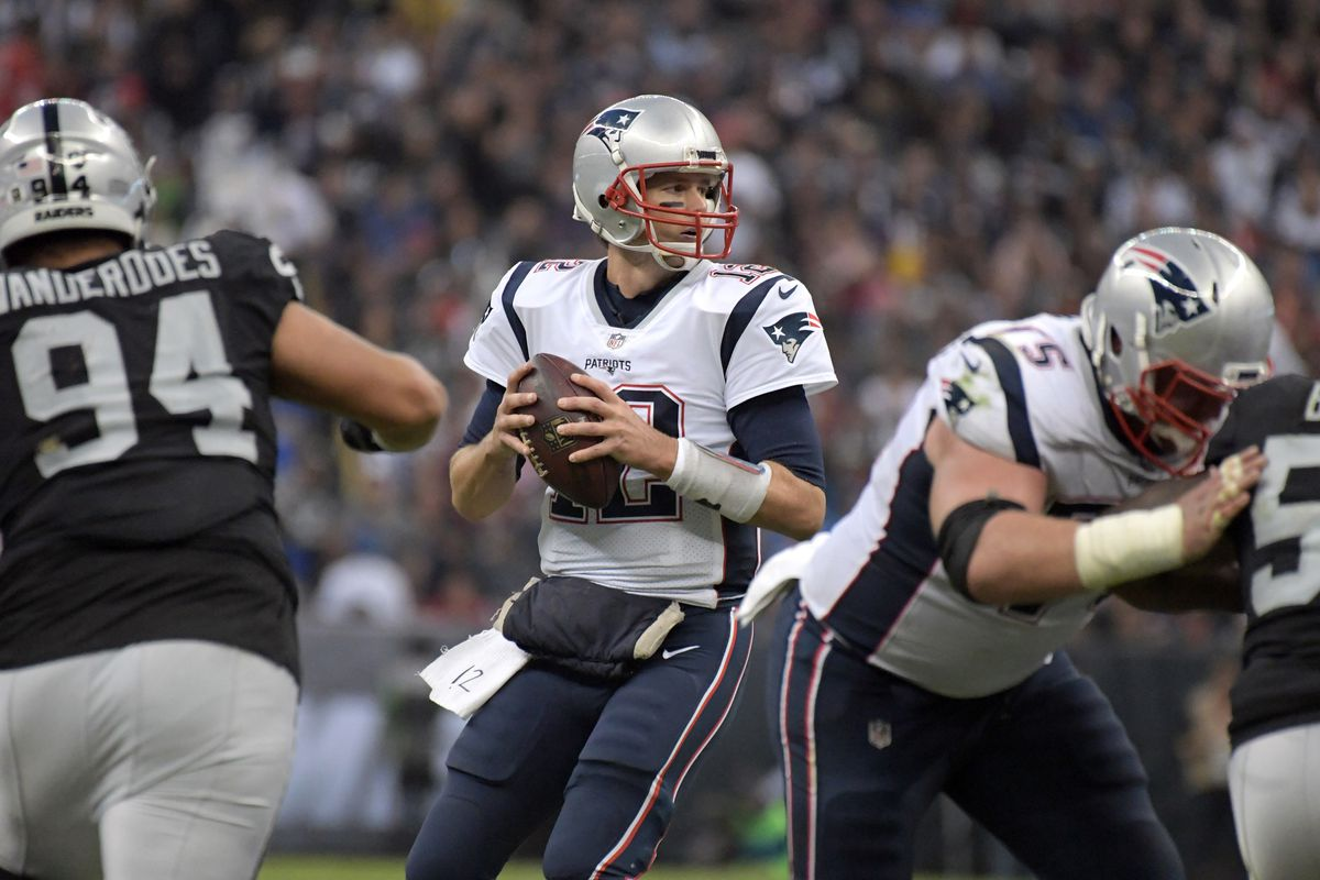 New England Patriots quarterback Tom Brady throws a pass against the Oakland Raiders during an NFL International Series game at Estadio Azteca.