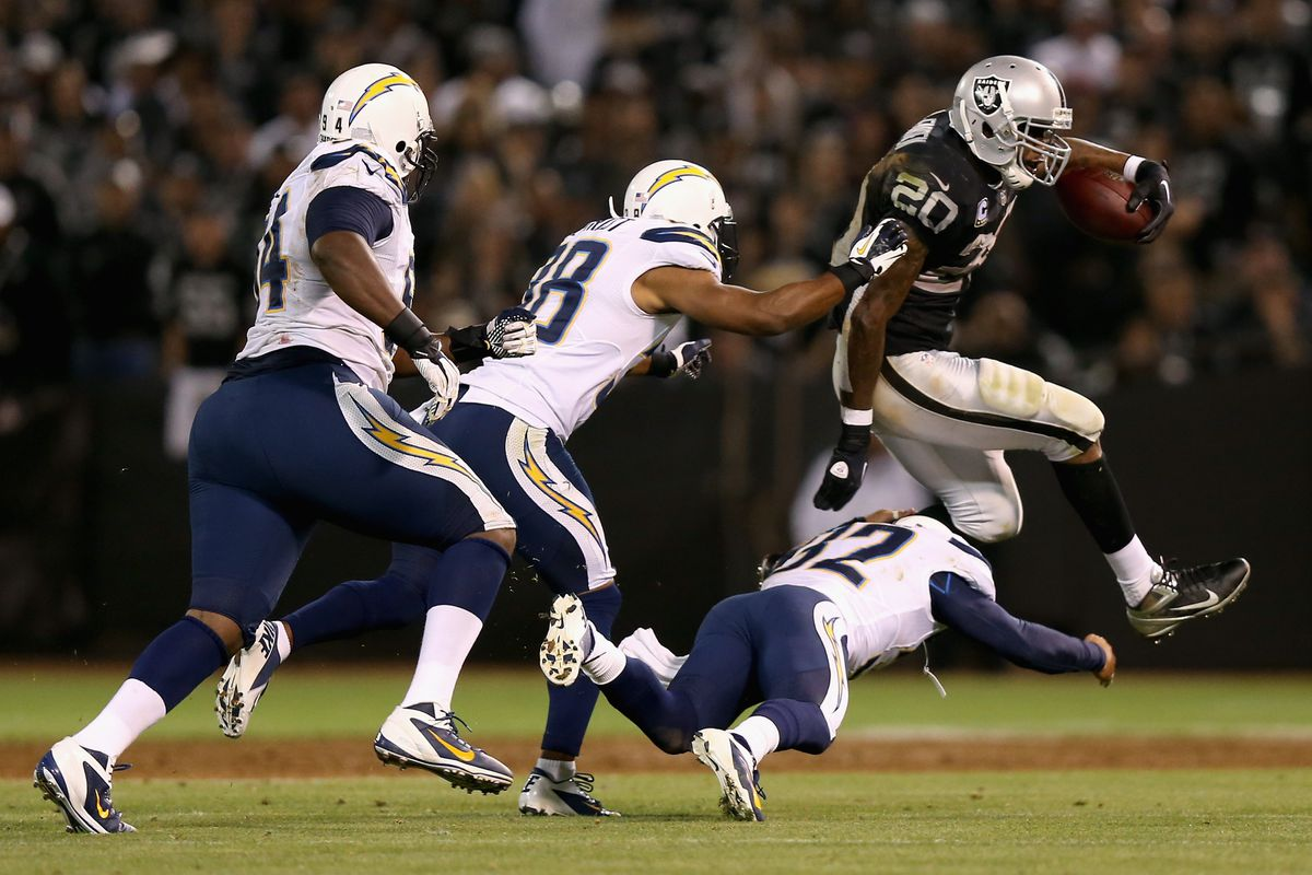 Darren McFadden #20 of the Oakland Raiders tries to avoid being tackled by the San Diego Chargers during their season opener