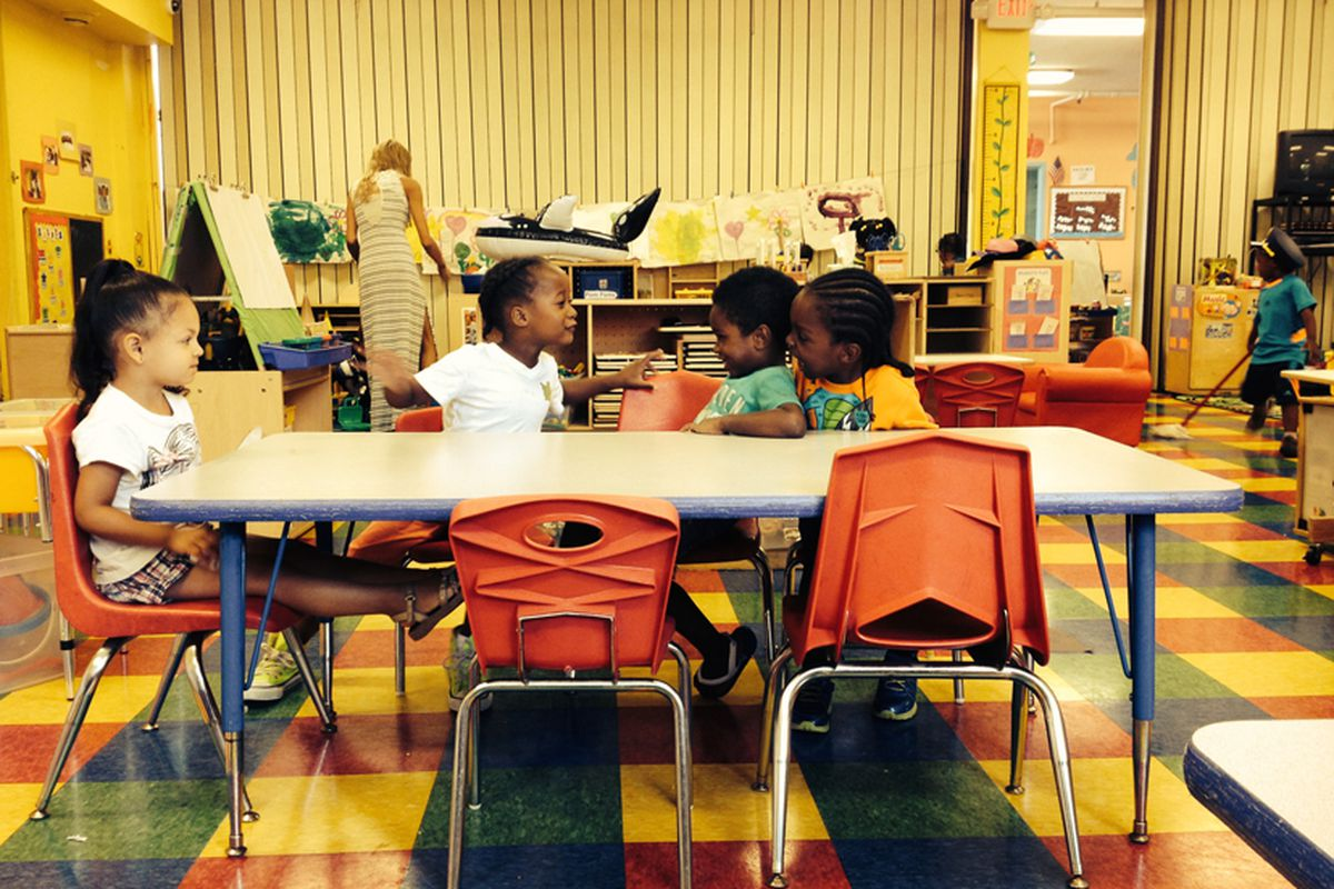 Kids wait to go outside at the Saratoga Early Childhood Education Center.