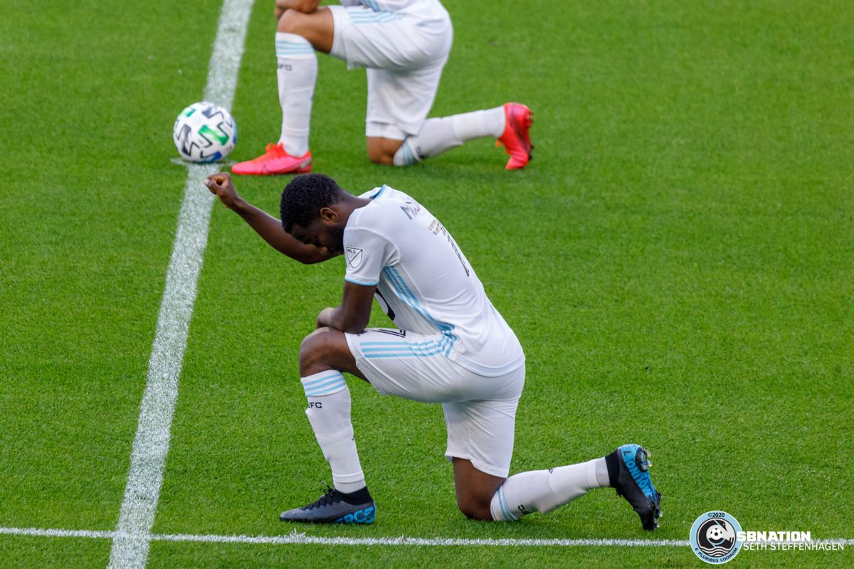 August 21, 2020 - Saint Paul, Minnesota, United States - Minnesota United midfielder Kevin Molino (7) and fellow players take a knee prior to kickoff of the Minnesota United vs Sporting KC match at Allianz Field.