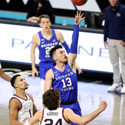Brigham Young Cougars guard Alex Barcello (13) puts up a shot over Gonzaga Bulldogs forward Corey Kispert (24) as BYU and Gonzaga play in the finals of the West Coast Conference tournament at the Orleans Arena in Las Vegas on Tuesday, March 9, 2021.