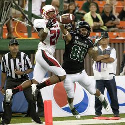 Hawaii wide receiver Jeremiah Ostrowski can't pull a pass in over Lamar defensive back Branden Thomas during the third quarter of the NCAA game between the Lamar and Hawaii, Sept. 15, 2012 in Honolulu.
