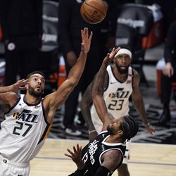 Los Angeles Clippers guard Paul George, right, shoots as Utah Jazz center Rudy Gobert defends during the second half of Game 3 of a second-round NBA basketball playoff series Saturday, June 12, 2021, in Los Angeles.