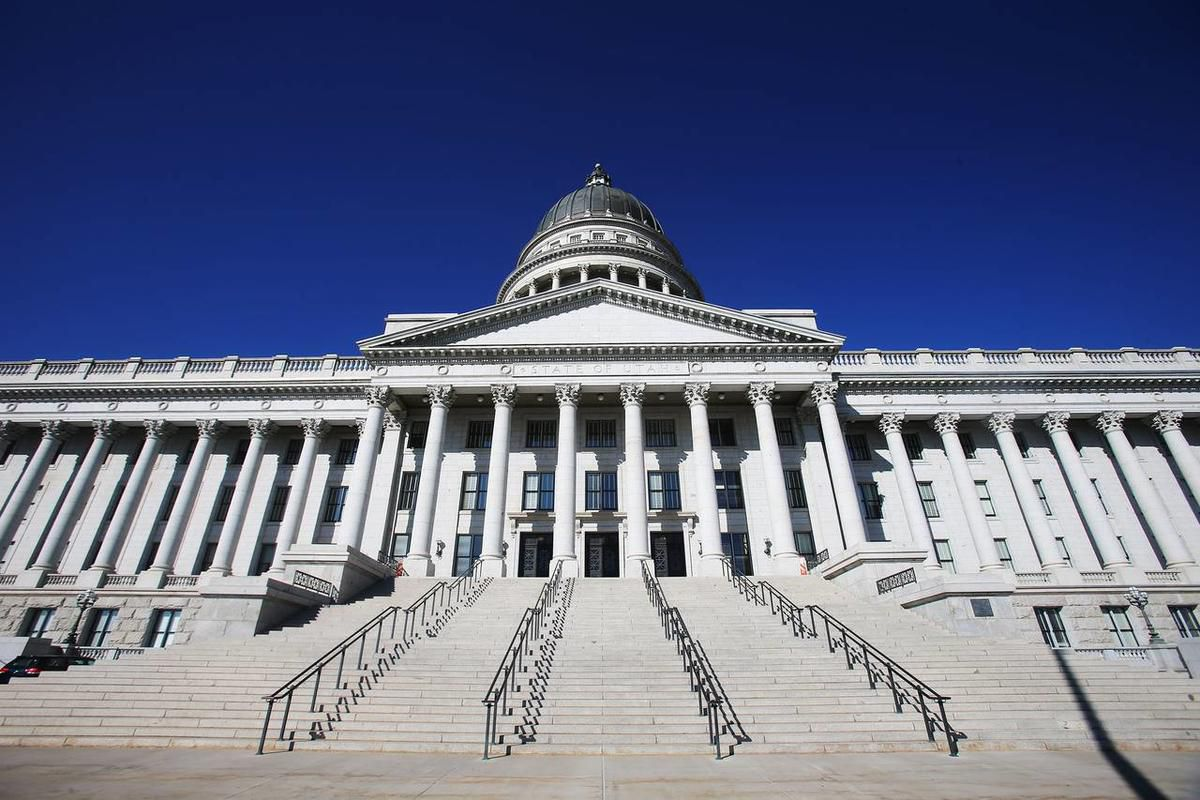 An environmental attorney and an information technology specialist recently were named as attorney and employee of 2013 for the Utah Attorney General's Office.
