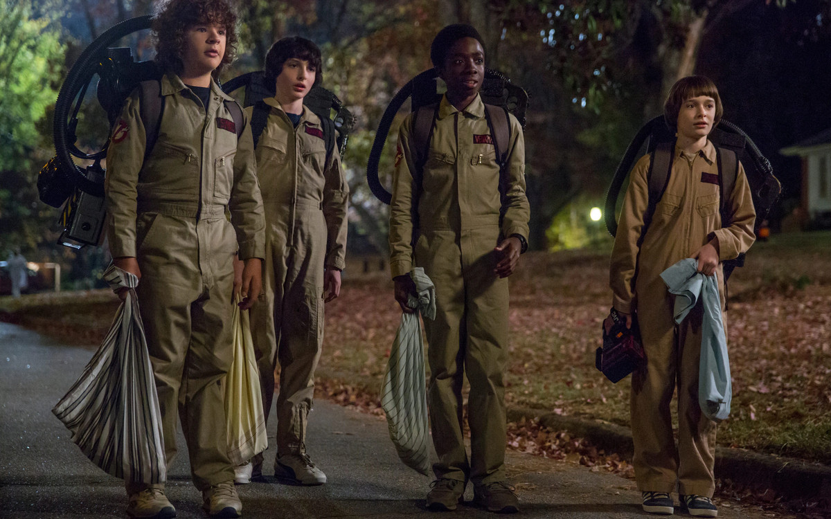 The Stranger Things gang dressed as the Ghostbusters gang