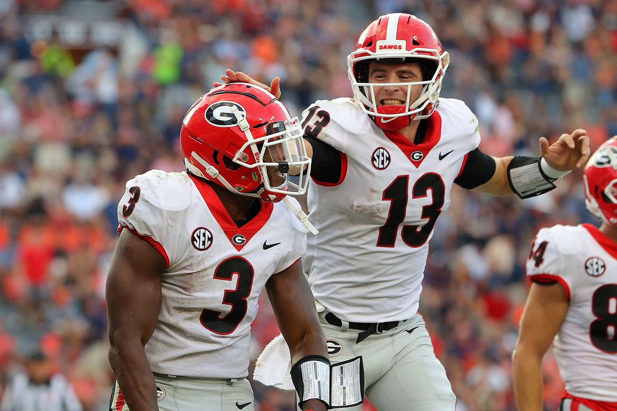 Zamir White of the Georgia Bulldogs reacts after rushing for a touchdown against the Auburn Tigers with Stetson Bennett during the second half at Jordan-Hare Stadium on October 09, 2021 in Auburn, Alabama.