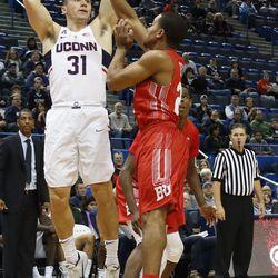 UConn's Michael Noyes (31) attempts a shot over a Boston University defender.