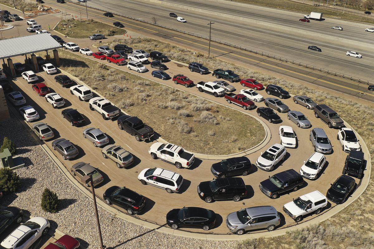 Hundreds of cars wait in line for hours at the Division of Motor Vehicles drive-thru window in Draper on Friday, April 3, 2020.Some waited in line for hours.
