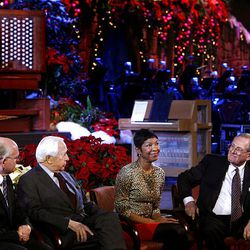 Mormon Tabernacle Choir music director Mack Wilberg, author David McCullough, singer Natalie Cole and choir president Mac Christensen speak to the media about the annual Christmas concert at the Conference Center in Salt Lake Friday.