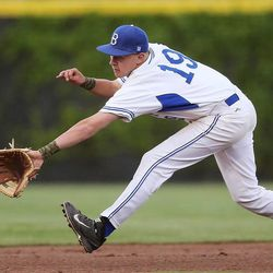 Bingham's Riley Akers tries to stop a ground ball as Bingham and Pleasant Grove play Wednesday, May 21, 2014 in a 5A one-loss bracket game at Kearns.