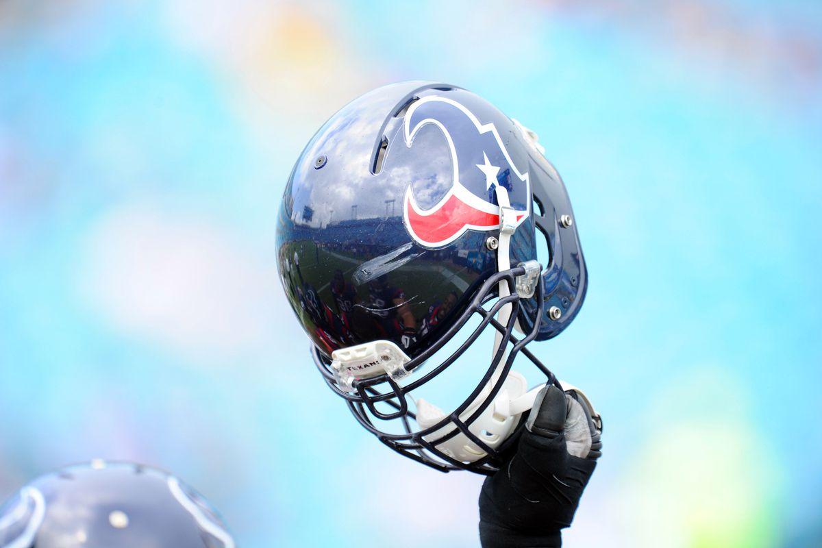 September 16, 2012; Jacksonville, FL, USA; A Houston Texans player holds up his helmet prior to the game against the Jacksonville Jaguars at EverBank Field. The Texans defeated the Jaguars 27-7. Mandatory Credit: Dale Zanine-US PRESSWIRE