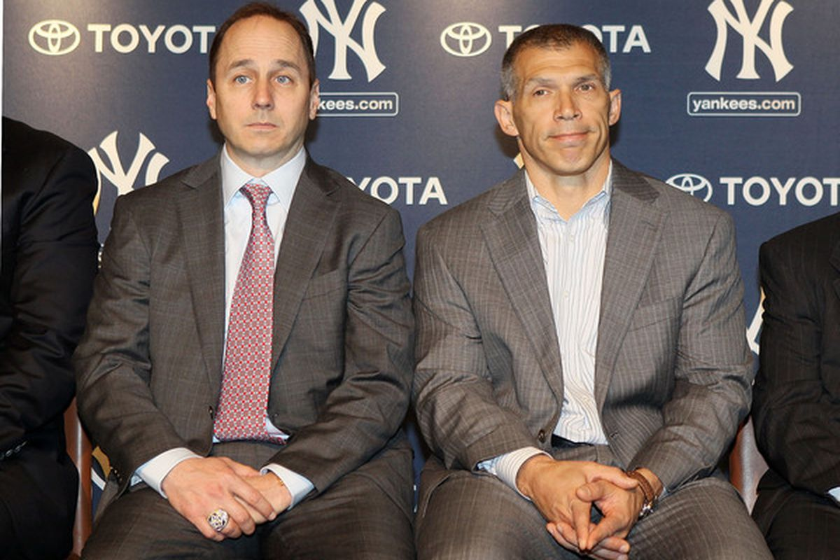 """Cashman - """"You and your love of defensive catc..."""" Girardi - """"He'll come around!""""  (Photo by Jim McIsaac/Getty Images)"""