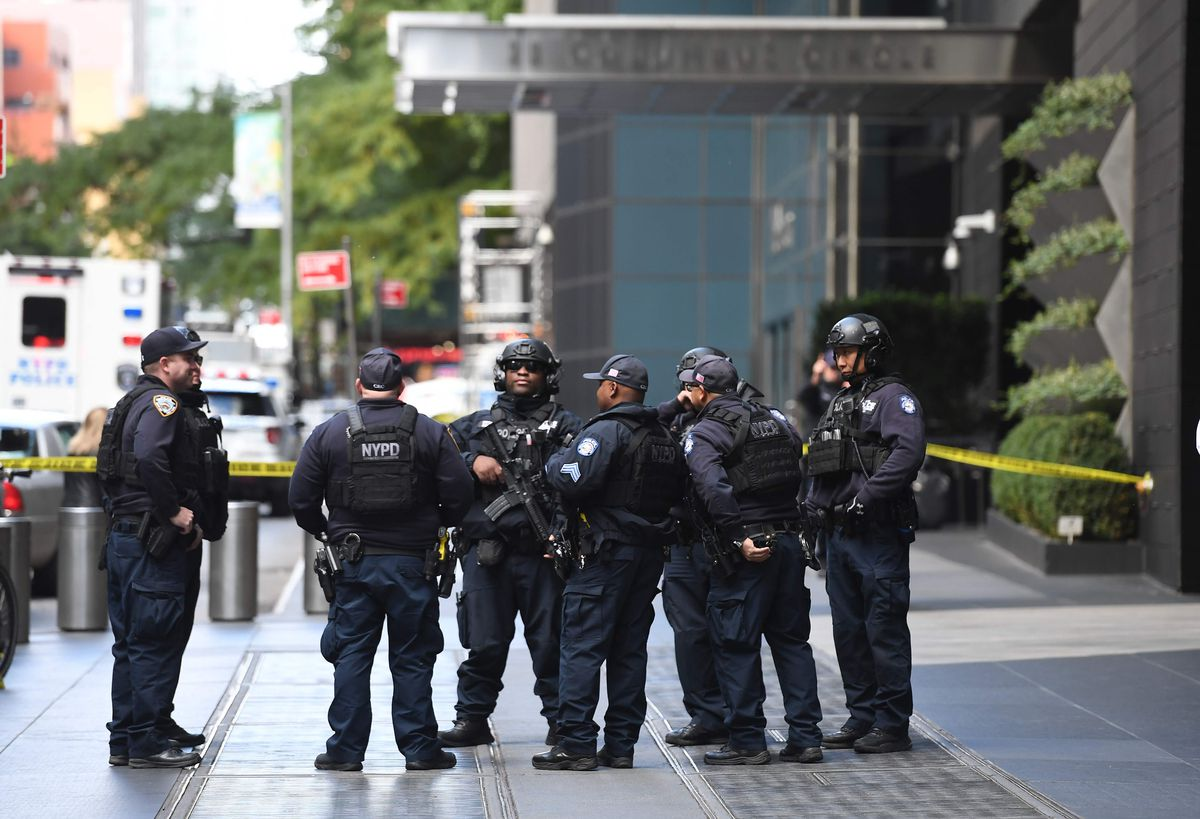 Police stand outside the Time Warner Building on Wednesday. A suspected explosive device was found in the building after it was delivered to CNN's New York bureau. | Timothy A. Clary/AFP/Getty Images