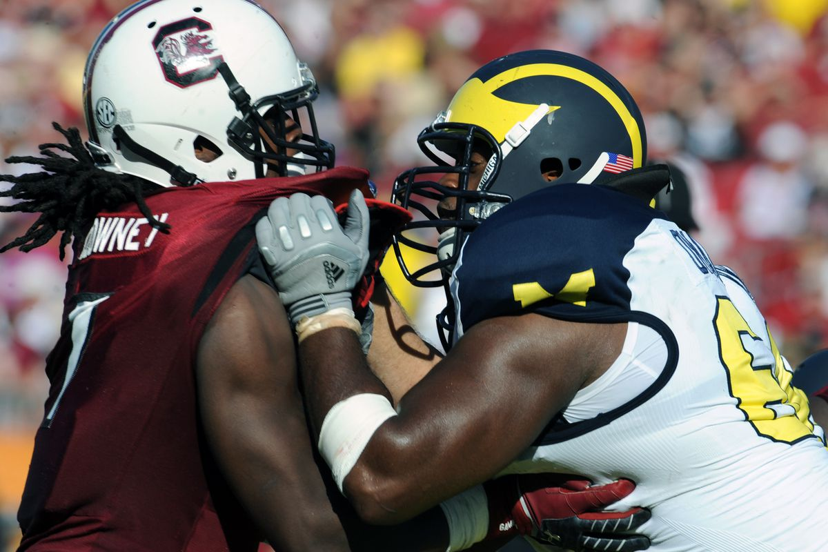 TAMPA, FL - JANUARY 01:  Defensive end Jadeveon Clowney #7 of the South Carolina Gamecocks rushes up field during a 33 - 28  victory against the Michigan Wolverines in the Outback Bowl January 1, 2013 at Raymond James Stadium in Tampa, Florida.  (Photo by Al Messerschmidt/Getty Images)