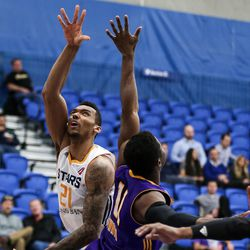 Salt Lake City Stars forward Joel Bolomboy (21) lays it up over Los Angeles D-Fenders guard David Nwaba (11) at the Lifetime Activities Center in Taylorsville on Wednesday, Feb. 08, 2017.