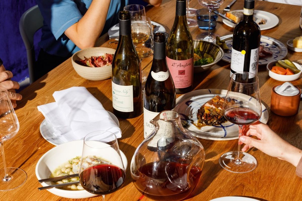 A selection of wines and French dishes in white dinnerware at Planque, which has opened in Haggerston