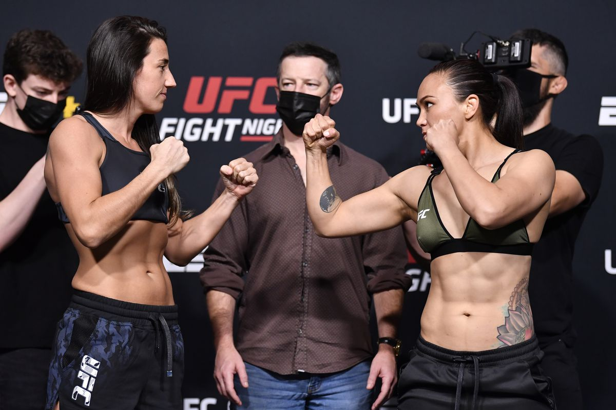 Opponents Marina Rodriguez of Brazil and Michelle Waterson face off during the UFC weigh-in at UFC APEX on May 07, 2021 in Las Vegas, Nevada.