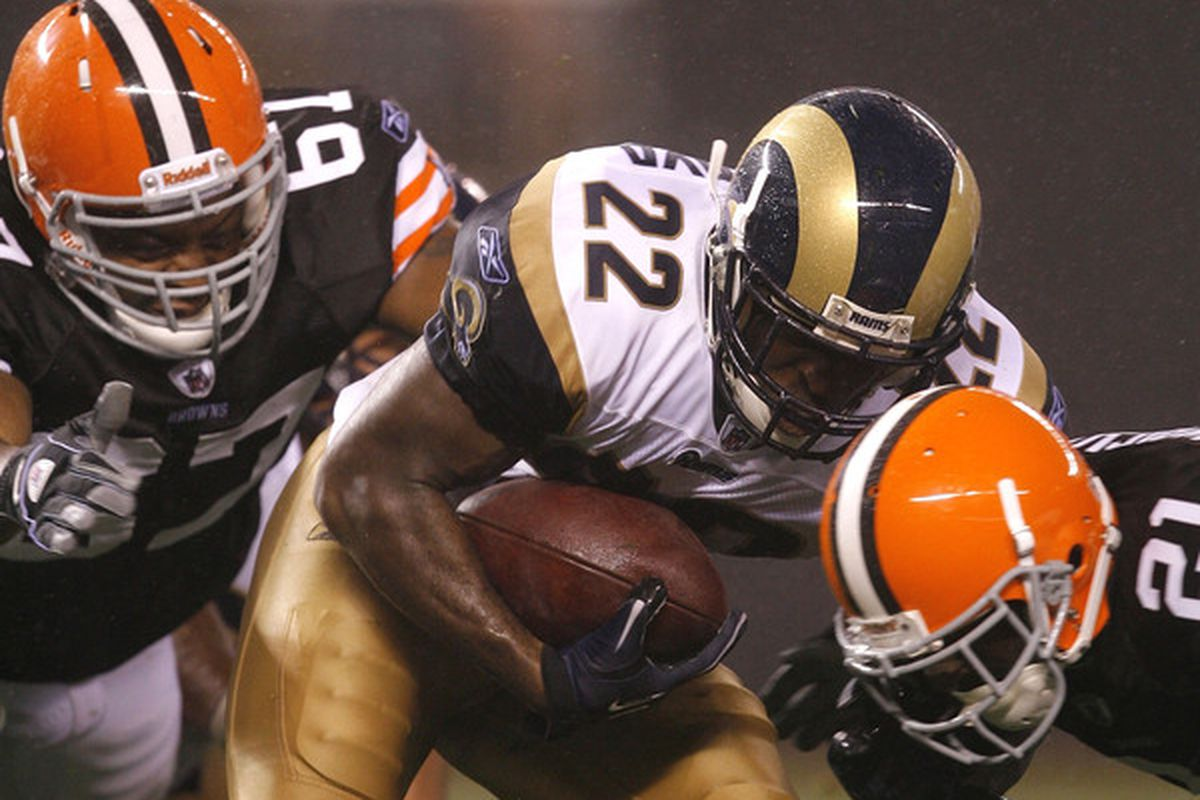 CLEVELAND - AUGUST 21:  St. Louis Rams #22 Chris Ogbonnaya is hit by #61 Joel Reinders and #21 Eric Wright of the Cleveland Browns at Cleveland Browns Stadium on August 21 2010 in Cleveland Ohio.  (Photo by Matt Sullivan/Getty Images)