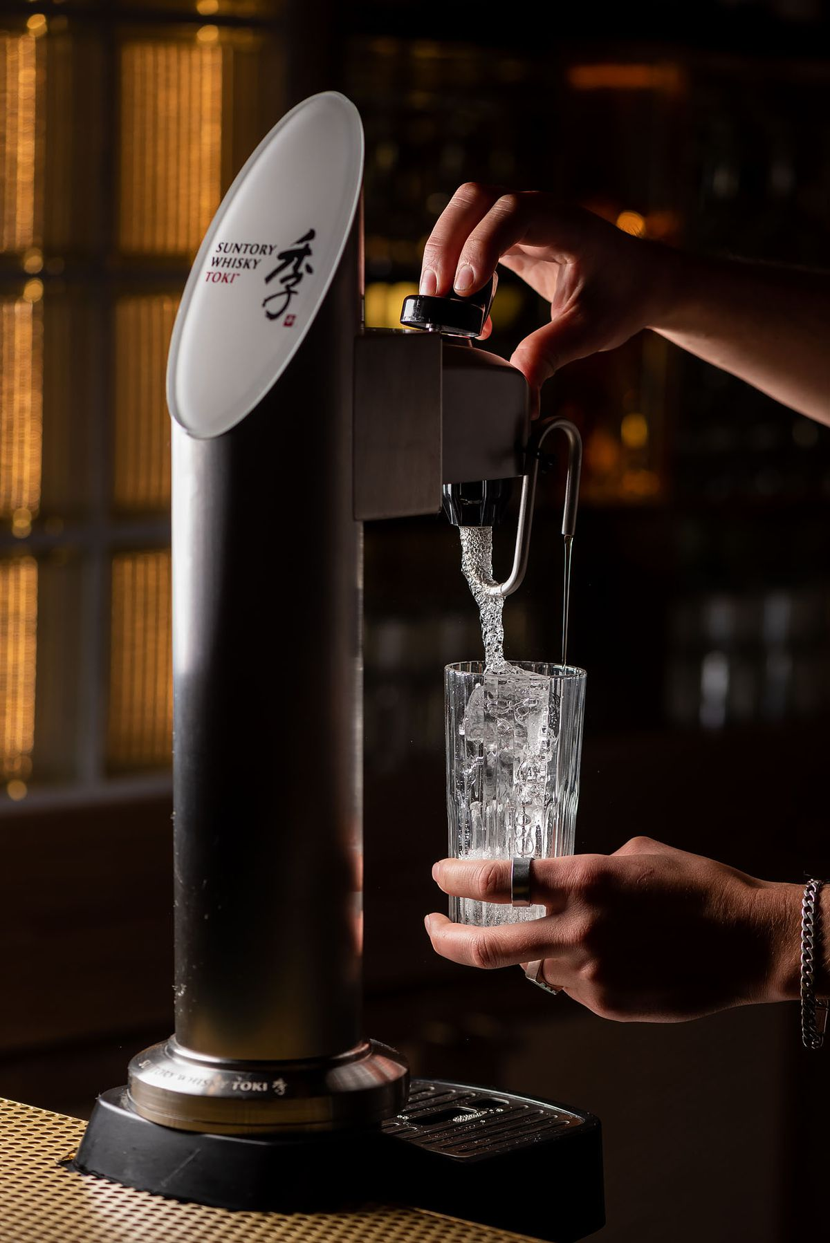 A Suntory toki highball machine pours alcohol.