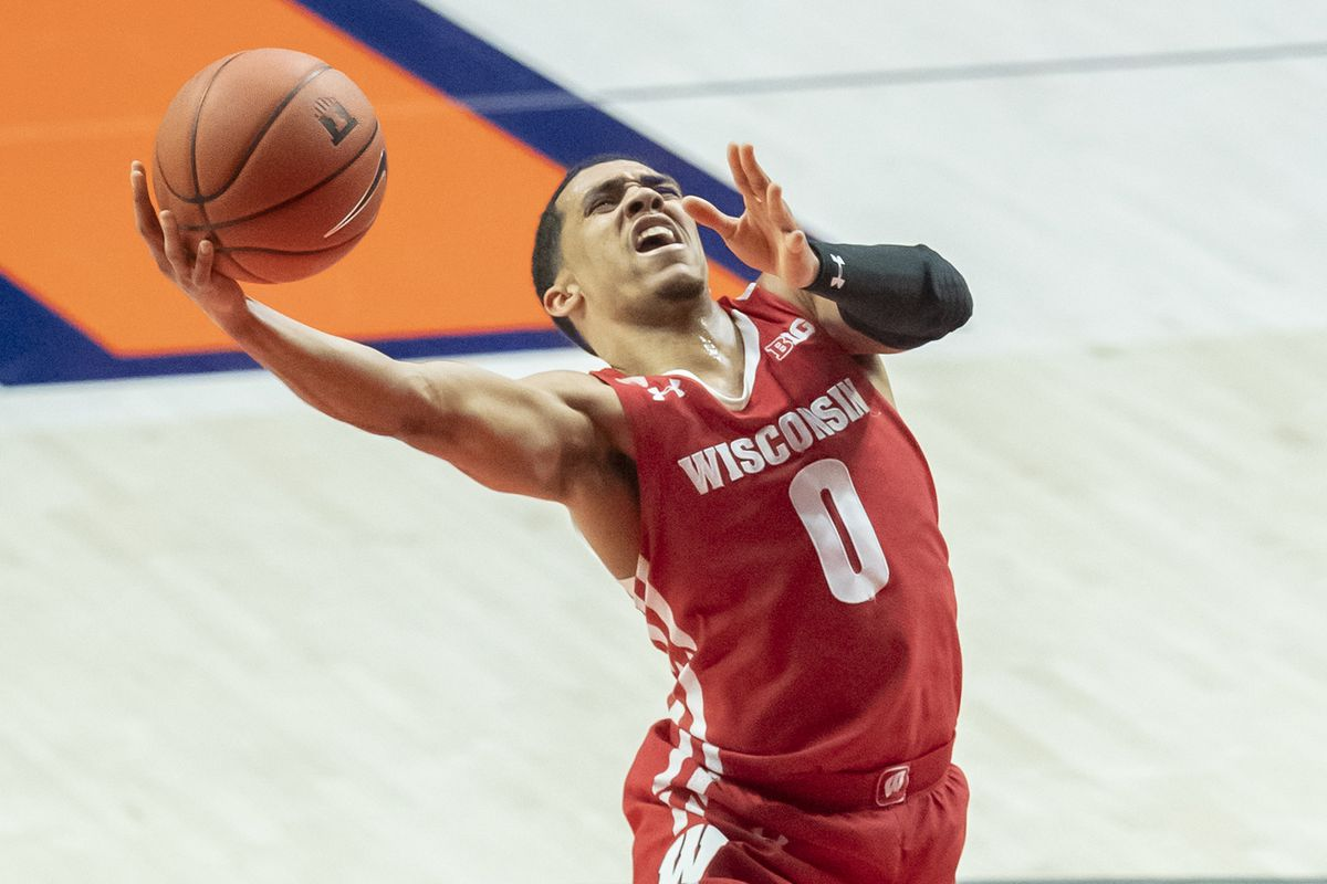 Wisconsin Badgers guard D'Mitrik Trice goes up for a layup during the second half against the Illinois Fighting Illini at State Farm Center.